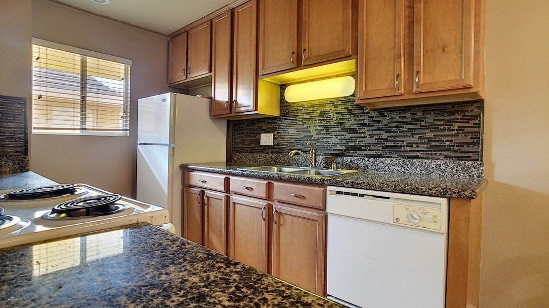 Kitchen featuring cabinets and marble