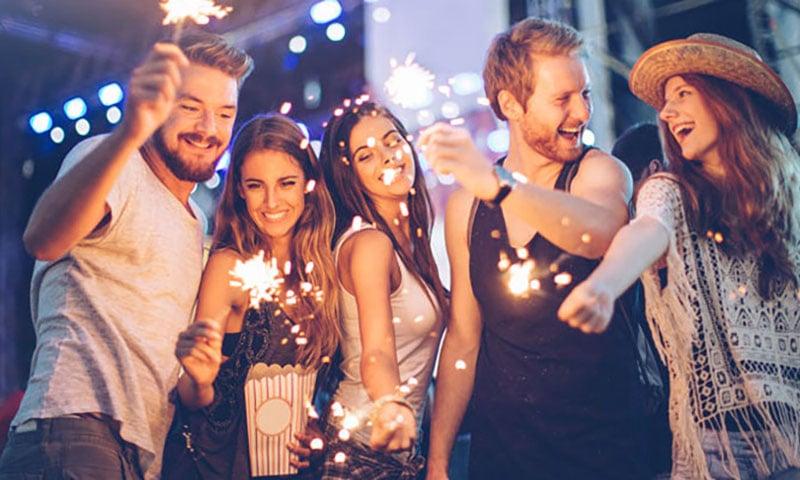 group-socializing-sparklers-festival