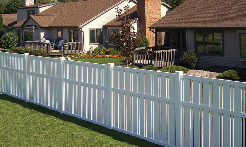 Simple plastic/vinyl fencing around residential area