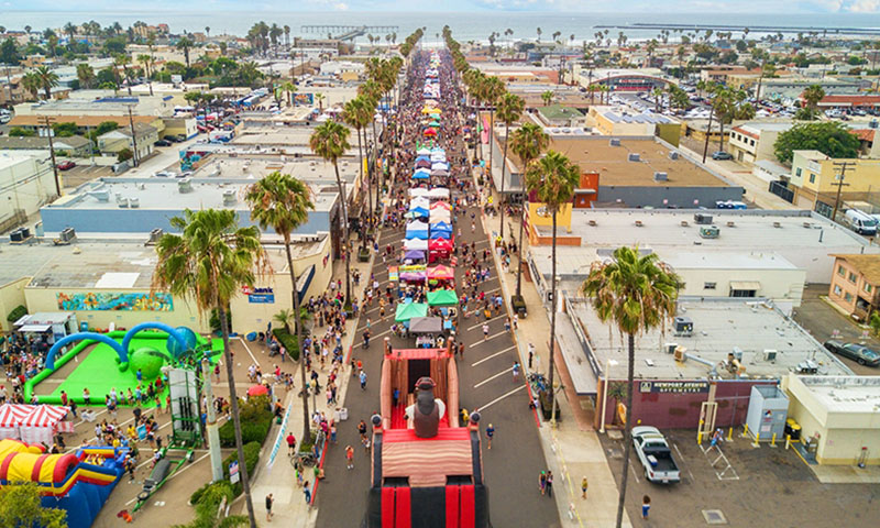 Arial View of busy street fair and chilli cook off in Ocean Beach San Diego
