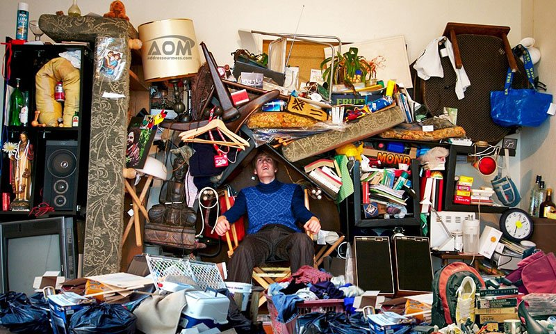Man/Hoarder surrounded by stuff