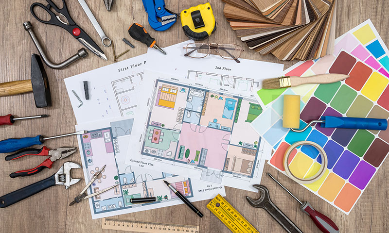 variety of home renovation tools and plan